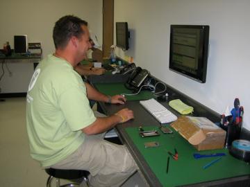 Mission Repair iPod and MacBook tech repair stations.